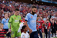 February 18, 2017:  Sydney FC forward Alex BROSQUE (captain) (14) leads out his team at Round 20 of the 2016 Hyundai A-League match, between Western Sydney Wanderers and Sydney FC, played at ANZ Stadium in Sydney.