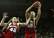 21 JANUARY 2009: Wisconsin's Joe Krabbenhoft (45) pulls in a rebound while teammate Kevin Gullikson (43) battles a defender during the first half of an NCAA college basketball game Wednesday, Jan. 21, 2009, at Carver-Hawkeye Arena in Iowa City, Iowa. Iowa defeated Wisconsin 73-69 in overtime.