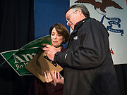 05 DECEMBER 2019 - DES MOINES, IOWA: US Senator AMY KLOBUCHAR (D-MN) signs a yard sign for a voter after making a speech at a campaign event in Des Moines. Sen. Klobuchar is campaigning to be the Democratic nominee for the US Presidency. Iowa holds the first selection event of the Presidential election cycle. The Iowa caucuses are Feb. 3, 2020.         PHOTO BY JACK KURTZ
