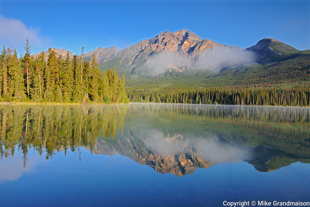 Pyramid Mountain reflected in Pyramid Lake at sunrise, Jasper National Park, Alberta, Canada