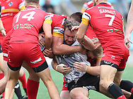 Jake Emmitt of Toronto Wolfpack  tackled by Alex Walker and Jarrod Sammut of London Broncos during the Super 8s Qualifiers Million Pound Game at Lamport Stadium, Toronto, Canada<br /> Picture by Stephen Gaunt/Focus Images Ltd +447904 833202<br /> 07/10/2018