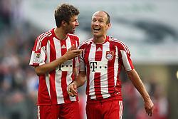 30-04-2011 VOETBAL: BAYERN MUNCHEN - FC SCHALKE 04: MUNCHEN<br /> Thomas Mueller (Bayern #25) und Arjen Robben (Bayern #10) nach dem Spie<br /> ***NETHERLANDS ONLY***<br /> ©2011- FotoHoogendoorn.nl-nph/ Straubmeier