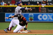 PHOENIX, AZ - MAY 28:  Yangervis Solarte #26 of the San Diego Padres makes the out over the sliding Jake Lamb #22 of the Arizona Diamondbacks in the first inning at Chase Field on May 28, 2016 in Phoenix, Arizona.  (Photo by Jennifer Stewart/Getty Images)