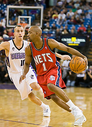November 27, 2009; Sacramento, CA, USA;  New Jersey Nets guard Rafer Alston (1) is guarded by Sacramento Kings guard Sergio Rodriguez (10) during the first quarter at the ARCO Arena. Sacramento defeated New Jersey 109-96.