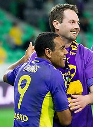 Marcos Tavares of Maribor and fan Matjaz Muster celebrate after the penalty shots during football match between NK Celje and NK Maribor in final of Hervis Cup 2011/12, on May 23, 2012 in SRC Stozice, Ljubljana, Slovenia. Maribor defeated Celje after penalty shots and became Slovenian Cup Champion. (Photo by Vid Ponikvar / Sportida.com)