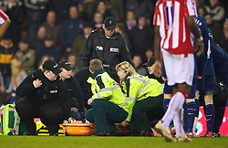 STOKE-ON-TRENT, ENGLAND - Saturday, February 27, 2010: Arsenal's Aaron Ramsey is carried off the pitch with medics giving him oxygen after he suffered a broken leg (fibia and tibia) during the FA Premier League match against Stoke City at the Britannia Stadium. (Photo by David Rawcliffe/Propaganda)