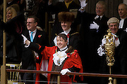Alderman and Rt Hon The Lord Mayor of London, Roger Gifford (L), a merchant banker with Swedish bank SEB waves to crowds during the Lord Mayor's Show. He is the 685th in the City of London's ancient history. The new Mayor's procession consists of a 3-mile, 150-float parade of commercial and military organisations going back to medieval times. This is the oldest and longest civic procession in the world that has survived the Plague and the Blitz, today one of the best-loved pageants. Henry Fitz-Ailwyn was the first Lord Mayor (1189-1212) and ever since, eminent city fathers (and one woman) have taken the role of the sovereign's representative in the City - London's ancient, self-governing financial district. The role ensured the King had an ally within the prosperous enclave.