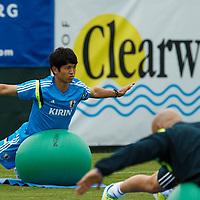 Samurai Blue players runs laps around field during the Japanese Football Association's presentation camp in Clearwater, Florida May 30, 2014. Scott Audette Inc./Scott Audette