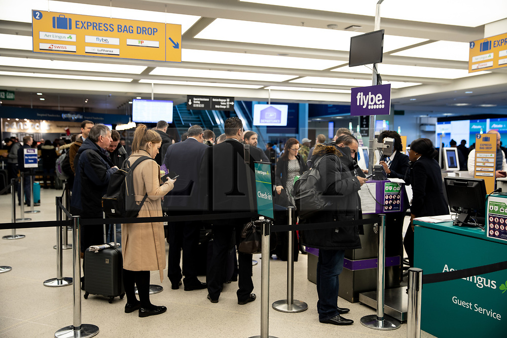 © Licensed to London News Pictures. 27/11/2018. London, UK. Passengers wait in London City airport as thick fog causes major travel disruption to flights to and from the airport. Currently, most flights are either cancelled or severely delayed. Photo credit : Tom Nicholson/LNP