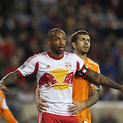 Thierry Henry, New York Red Bulls, is tightly marked by Eric Brunner, Houston Dynamo,  during the New York Red Bulls V Houston Dynamo, Major League Soccer second leg of the Eastern Conference Semifinals match at Red Bull Arena, Harrison, New Jersey. USA. 6th November 2013. Photo Tim Clayton