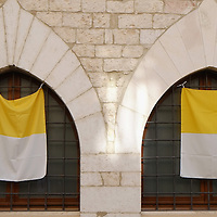 ASSISI, ITALY - OCTOBER 03:  Vatican flags are on display in Assisi ahead of the visit of Pope Francis on October 3, 2013 in Assisi, Italy. Pope Francis is due to venerate the tomb of San Francesco of Assisi tomorrow during his one-day visit to the city.  (Photo by Marco Secchi/Getty Images)