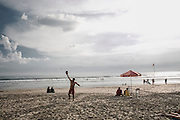 BALI, INDONESIA; APRIL 16, 2015: A life guard play beach tennis at Double Six beach, Bali, Indonesia on Thursday, April 16. 2015.