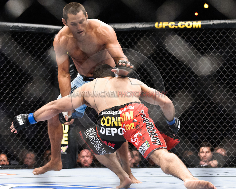 """ATLANTA, GEORGIA, SEPTEMBER 6, 2008: Dan Henderson (facing) fends off a takedown attempt by Rousimar Palhares during """"UFC 88: Breakthrough"""" inside Philips Arena in Atlanta, Georgia on September 6, 2008"""