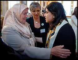 Image ©Licensed to i-Images Picture Agency. 08/07/2014. London, United Kingdom. Sayeeda Warsi meets Mejra Duguz  a mother of Srebrenica at the Srebrenica Memorial Reception at Lancaster House. Picture by Andrew Parsons / i-Images