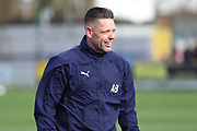 AFC Wimbledon goalkeeping coach Ashley Bayes smiling during the EFL Sky Bet League 1 match between AFC Wimbledon and Doncaster Rovers at the Cherry Red Records Stadium, Kingston, England on 9 March 2019.