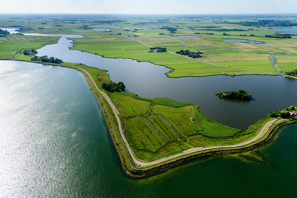 Nederland, Noord-Holland, Waterland, 13-06-2017; Uitdammer Die en Uitdammerdijk.<br /> De dijk staat op de nominatie om verstrekt te worden, bewoners en actievoerders vrezen aantasting van de monumentale dijk en verlies culturele waarden.<br /> Barnegat en Uitdammerdijk, rural area, North of Amsterdam.<br /> The dike is nominated to be reinforced, residents and activists fear losing the monumental quality of the dike and losing other cultural values.<br /> luchtfoto (toeslag op standaard tarieven);<br /> aerial photo (additional fee required);<br /> copyright foto/photo Siebe Swart