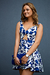 LIVERPOOL, ENGLAND - Thursday, April 6, 2017: Gabby Pippard, 21 from the Wirral, wearing a blue and white rose print dress from Top Shop, during The Opening Day on Day One of the Aintree Grand National Festival 2017 at Aintree Racecourse. (Pic by David Rawcliffe/Propaganda)