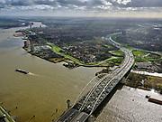Nederland, Zuid-Holland, Rotterdam, 25-02-2020; Van Brienenoordbrug over de Nieuwe Maas. De brug bestaat uit twee boogbruggen en huisvest Rijksweg A16, richting Breda. Gezien naar IJsselmonde, Beverwaard.<br /> Van Brienenoord bridge over the Nieuwe Maas. The bridge consists of two arched bridges. Motorway / highway A16, direction Breda.<br /> <br /> luchtfoto (toeslag op standard tarieven);<br /> aerial photo (additional fee required)<br /> copyright © 2020 foto/photo Siebe Swart