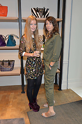 Left to right, KATIE READMAN and KATE MARTIN at a lunch hosted by Alice Naylor-Leyland and Tamara Beckwith in celebration of the Coach 2015 collection held at Coach, New Bond Street, London on 18th September 2014.