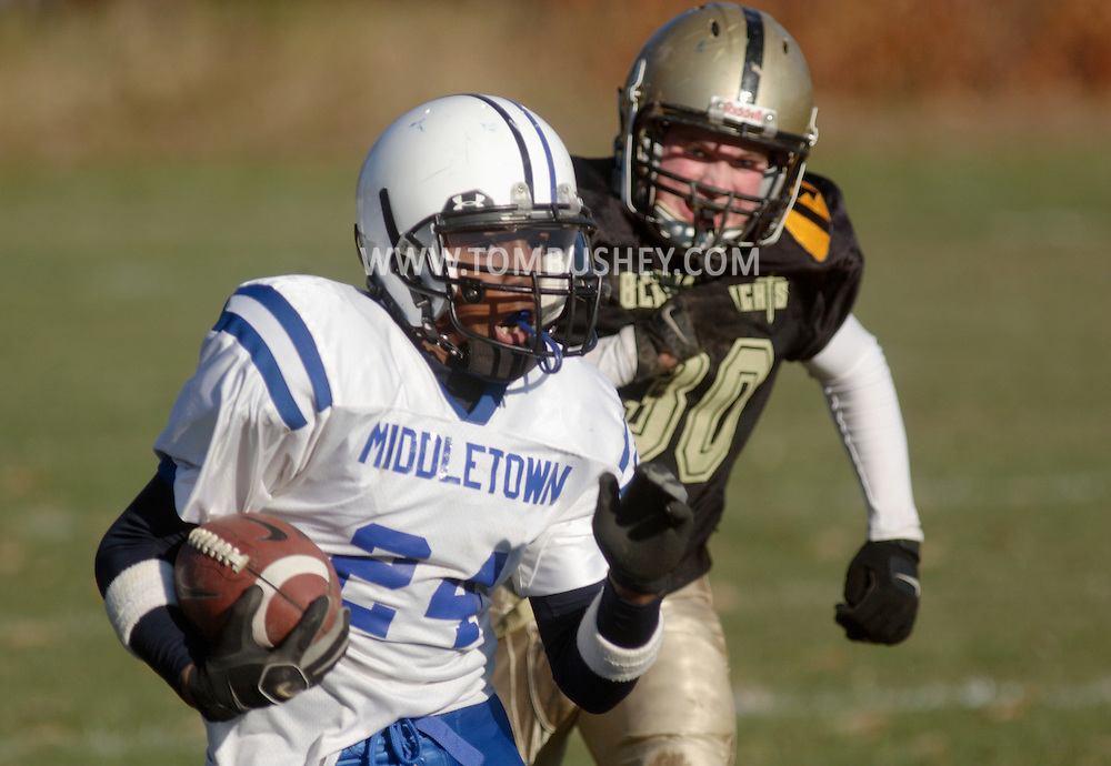 Middletown, NY - A Middletown running back carries the ball during an Orange County Youth Football League game against Highland Falls at Watts Park in Middletown on Nov. 11, 2007.