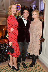 Left to right, EVA HERZIGOVA, STEFANO GABBANA and LAURA BAILEY at the Claridge's Christmas Tree By Dolce & Gabbana Launch Party held at Claridge's, Brook Street, London on 26th November 2013.