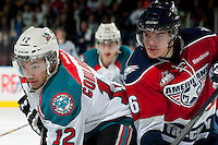 KELOWNA, CANADA - MARCH 23: Tyrell Goulbourne #12 of the Kelowna Rockets faces off against the Tri-City Americans on March 23, 2014 at Prospera Place in Kelowna, British Columbia, Canada.   (Photo by Marissa Baecker/Shoot the Breeze)  *** Local Caption *** Tyrell Goulbourne;