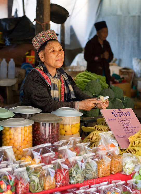 Woman selling dried fruit at a market, Doi Inthanon, Thailand