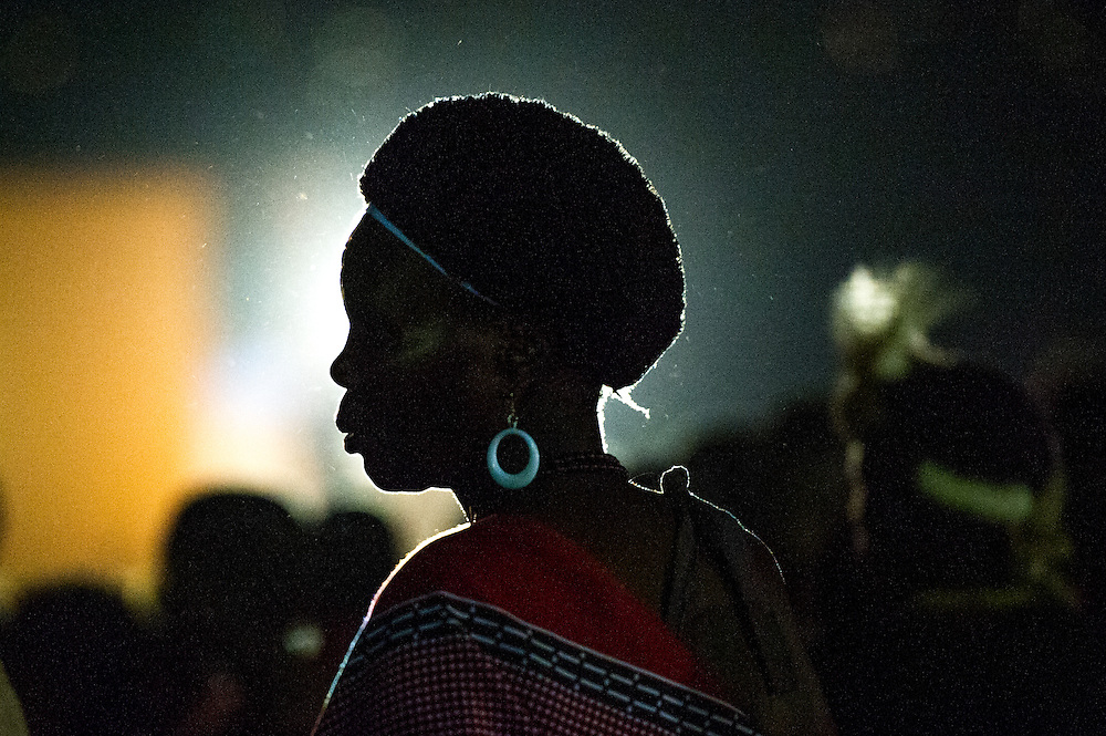 Silhouette of a Woman-Ludzidzini, Swaziland, Africa - The Swazi Umhlanga, or reed dance ceremony, 100,000 unmarried women , or maidens, celebrate their virginity by bringing reeds for the Swazi Queen Mother's Kraal during this 8 day long annual tradition and dancing in a massive gathering before King Mswati III, the royal family, and the public.