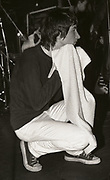 Bobby Gillespie of Primal Scream with towel on stage, UK, 1980s