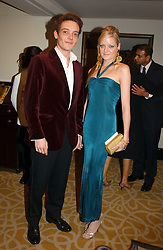 VISCOUNT ANSON and his sister LADY ELOISE ANSON at a dinner in aid of the BAAF (British Association for Adoption & Fostering) held at The Savoy, London on 22nd March 2005.<br /><br />NON EXCLUSIVE - WORLD RIGHTS