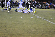 Water Valley's C.J. Jackson (26) blocks an extra point attempt in overtime vs. Mooreville to give the Blue Devils the win in Mooreville, Miss. on Friday, September 30, 2011. Water Valley won 21-20 in overtime.