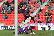 Blackpool forward Mark Cullen (9)  fails to beat Doncaster Rovers goalkeeper Remi Matthews (42) (On loan from  during the Sky Bet League 1 match between Doncaster Rovers and Blackpool at the Keepmoat Stadium, Doncaster, England on 28 March 2016. Photo by Simon Davies.