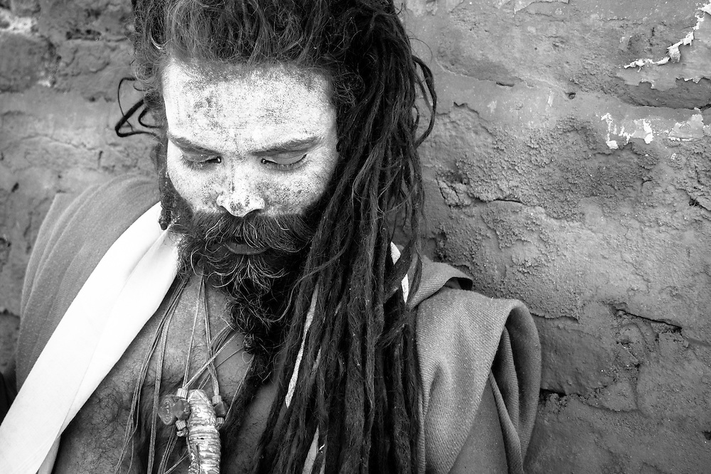 Black and white portrait of a sadhu (holy man) in yellow, at the holy hindu temples of Pashupatinath (Kathmandu, Nepal, 2011).