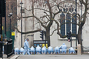 UNITED KINGDOM, London: 23 March 2017 A team of forensics officers get ready to conduct a finger tip search of Parliament Square this afternoon after a terror attack which killed four people including the attacker in Westminster yesterday. Rick Findler / Story Picture Agency