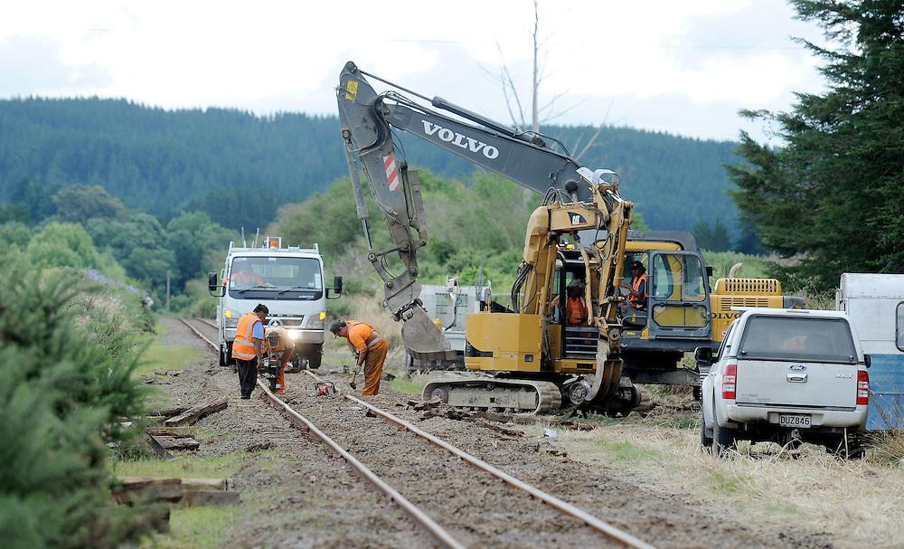 Kiwirail staff work to repair track following a freight train derailment south of Raupunga, Hawkes Bay, New Zealand, Sunday, January 22, 2012. Credit: SNPA / Kerry Marshall