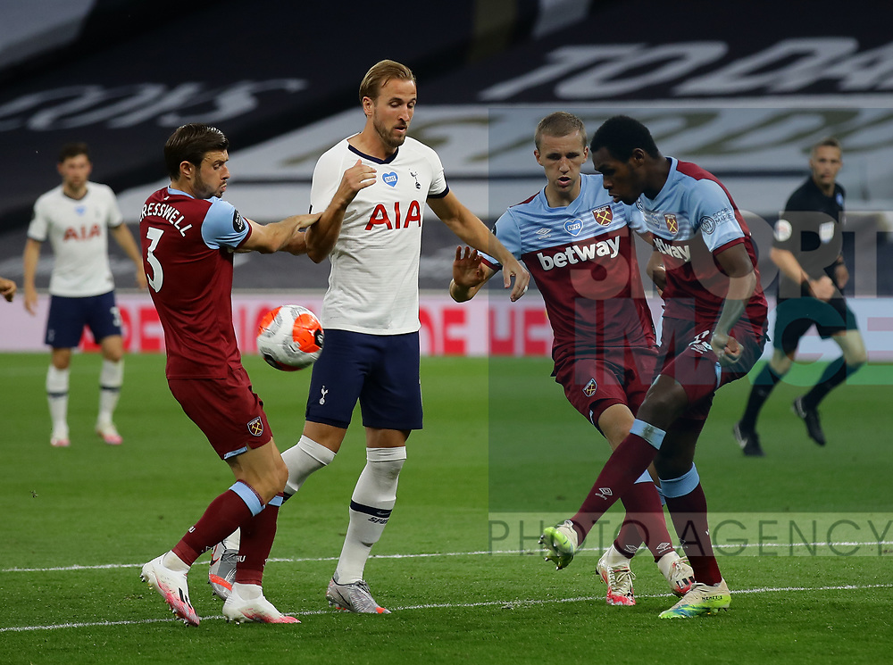 Aaron Cresswell and Issa Diop of West Ham United keep out Harry Kane of Tottenham during the Premier League match at the Tottenham Hotspur Stadium, London. Picture date: 23rd June 2020. Picture credit should read: David Klein/Sportimage
