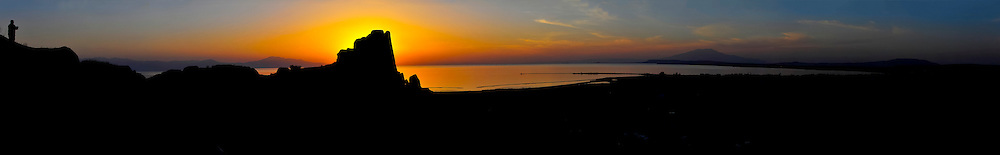 A sunset panorama over the ruins of Van Castle (Kalesi) and vivid colors across Van Sea and the surrounding countryside, Van, Eastern Anatolia, Turkey.