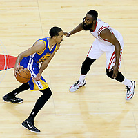 25 May 2015: Houston Rockets guard James Harden (13) defends on Golden State Warriors guard Shaun Livingston (34) during the Houston Rockets 128-115 victory over the Golden State Warriors, in game 4 of the Western Conference finals, at the Toyota Center, Houston, Texas, USA.
