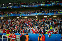LILLE, FRANCE - Friday, July 1, 2016: Wales supporters celebrate after the 3-1 victory over Belgium during the UEFA Euro 2016 Championship Quarter-Final match at the Stade Pierre Mauroy. (Pic by David Rawcliffe/Propaganda)