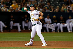 OAKLAND, CA - SEPTEMBER 21:  Matt Chapman #26 of the Oakland Athletics throws to first base against the Texas Rangers during the sixth inning at the RingCentral Coliseum on September 21, 2019 in Oakland, California. The Oakland Athletics defeated the Texas Rangers 12-3. (Photo by Jason O. Watson/Getty Images) *** Local Caption *** Matt Chapman