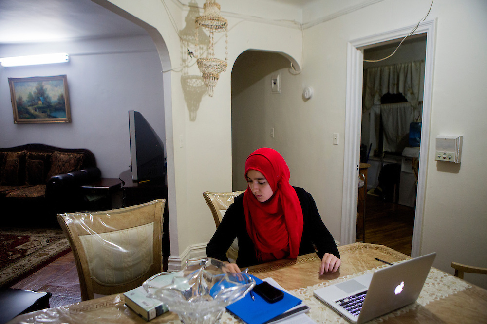 BRONX, NY - DECEMBER 10, 2015: Hebh Jamal, a 15-year-old Muslim, does homework at her family's apartment in the Bronx. CREDIT: Sam Hodgson for The New York Times.