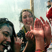 "Drake University students hit the shower after ""street painting day"", an annual event on campus where groups from dormitories, sororities and fraternities paint a section of a campus street.  Often more paint ends up on the students than on the pavement, which is part of the fun. ..The private University in Des Moines, Ia., has been lauded for it's outstanding programs in the arts in addition to having one of the best law schools and pharmacy departments in the country."