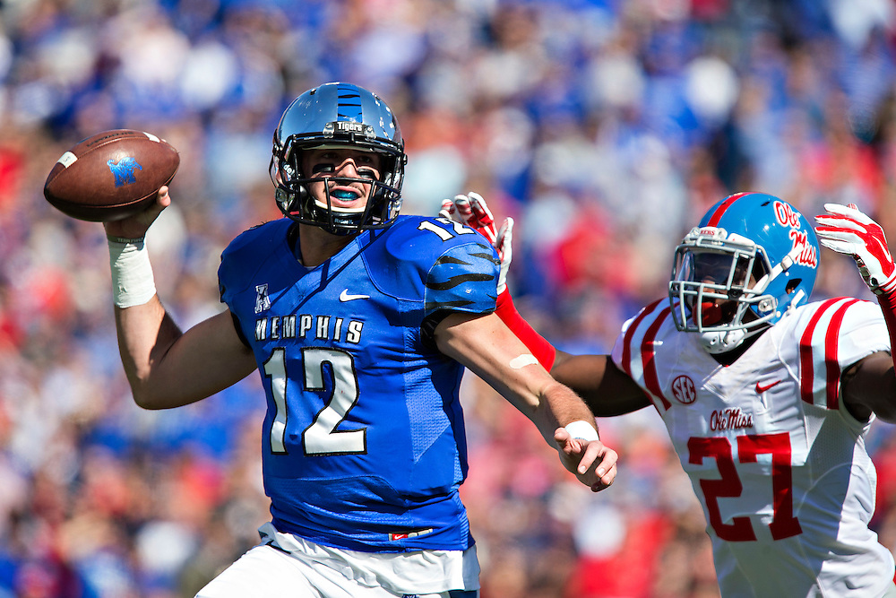 MEMPHIS, TN - OCTOBER 17:  Paxton Lynch #12 of the Memphis Tigers and is chased by Marquis Haynes #27 of the Ole Miss Rebels at Liberty Bowl Memorial Stadium on October 17, 2015 in Memphis, Tennessee.  The Tigers defeated the Rebels 37-24.  (Photo by Wesley Hitt/Getty Images) *** Local Caption *** Paxton Lynch; Marquis Haynes