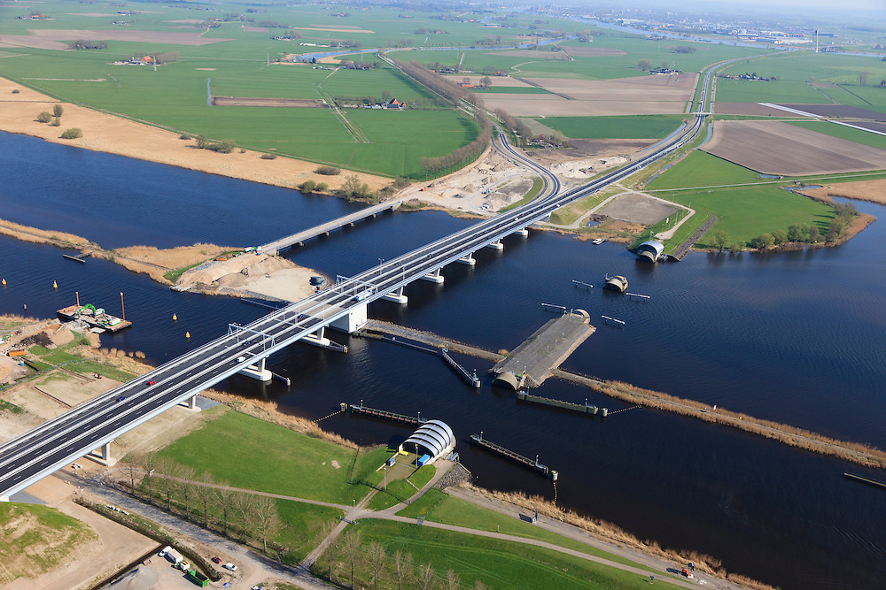 Nederland, Flevoland-Overijssel, Ramspol, 01-05-2013; nieuwe Ramspolbrug in de N50 gezien in de richting van Overijssel met voor de brug de balgstuw.  De vaargeul in het Ramsdiep met strekdam. Ramspol, inflatable dike, between Ketelmeer and Black Water. The Balgstuw (bellow barrier) is a storm barrier and consists of an inflatable dam or dyke, composed of three bellows. Usually, each bellow rests on the bottom of the water, but now the bellows are inflated  because of maintenance. luchtfoto (toeslag op standard tarieven)<br /> aerial photo (additional fee required)<br /> copyright foto/photo Siebe Swart<br /> luchtfoto (toeslag op standard tarieven)<br /> aerial photo (additional fee required)<br /> copyright foto/photo Siebe Swart