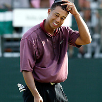 Tiger Woods tips his hat to the gallery after finshing the final round of the Disney Golf Classic with a missed birdie attempt  on the 18th hole on Sunday, Oct. 20, 2002, in Lake Buena Vista, Fla. (AP Photo/Scott Audette)