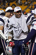 PITTSBURGH - JANUARY 23:  Running back Corey Dillon #28 of the New England Patriots celebrates on the sideline after running the ball 24 times for 73 yards and a touchdown against the Pittsburgh Steelers during the AFC Championship game at Heinz Field on January 23, 2005 in Pittsburgh, Pennsylvania. The Pats defeated the Steelers 41-27. ©Paul Anthony Spinelli  *** Local Caption *** Corey Dillon