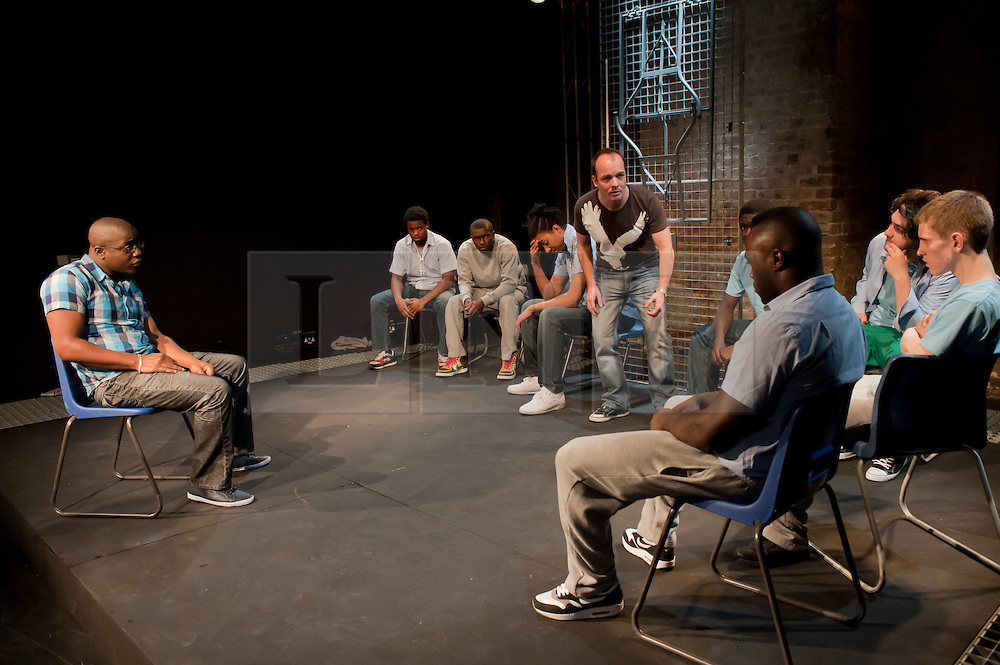 """© Copyright licensed to London News Pictures. 12/11/2010. """"Inside"""" by Philip Osment, presented by Playing Out at the Roundhouse, Camden, London. Based on the real experiences of young fathers in prison, the play deals with big questions surrounding relationships, both with their own fathers and with their children. The cast: Jim Pope, Andre Skeete, Ayo Bodunrin, Kyle Thorne, Michael Amaning, Darren Douglas, Segun Olaiya, Jacob James Beswick, Tarkan Cetinkaya."""