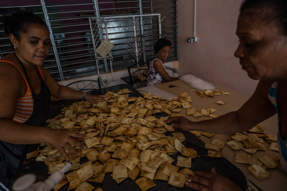 HAVANA, CUBA - JUNE 18, 2015:  Women make crackers at a state-owned bakery in Central Havana. After more than half a century defined by mistrust and rancor, the United States will officially reopen its six-story embassy in Havana on Monday, marking a watershed moment of transition for the two countries as they lean toward closer diplomatic ties and ease past one of the last remnants of the Cold War.  President Barack Obama, when announcing an end to the diplomatic freeze, eased travel restrictions, opened the door for more remittances to Cuba and expanded the amount of goods that visiting Americans could bring back home – like Cuban cigars and rum. He even removed the country from the list of nations that sponsor terrorism. President Raul Castro, meanwhile, has spent the last five years, before the thaw even began with the Obama administration, attempting to alter his nation's economic dysfunction, ordering the firing of government employees, encouraging a slow but fresh influx of Cubans into self-employment and even creating a special economic zone in the coastal city of Mariel to attract foreign investment.  PHOTO: Meridith Kohut for The New York Times