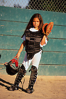Young Catcher Standing on Sidelines --- Image by © Jim Cummins/CORBIS