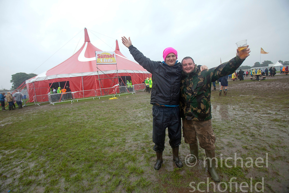 Fans in the mud, Saturday, at T in the Park 2012, held at Balado, in Fife, Scotland..